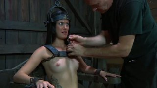 Poor Hailey Young is locked up on a special BDSM style chair image