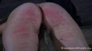 Cherry Torn gets whipped tough in a hardcore BDSM action image