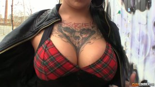 Tattooed and pierced slut gives a blowjob to oversized cock image