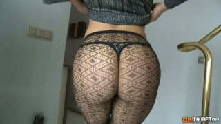 Big Bottomed girl in sexy pantyhose wagging her ass image
