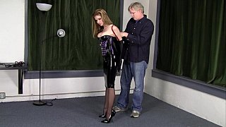 Bondage fetish with a babe in latex outfit image