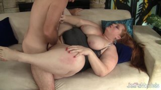 Image: Redhead Plumper Julie Ann More Gets Her Feet Worshiped and Pussy Stretched
