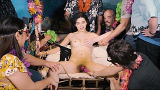 Colourful BDSM party with a brunette slave image