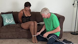 Ebony mature getting tied up and ball-gagged image