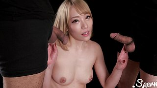 Asian babe sucking two small cocks image