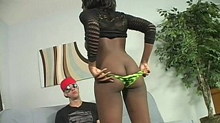 Big titted ebony pleases a big white_cock image