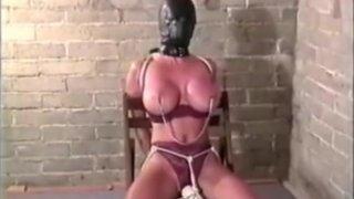 Woman Locks Herself Into Leather Hood image