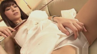 Horny Yuria Tominaga plays a violin and_rubs her_pussy image