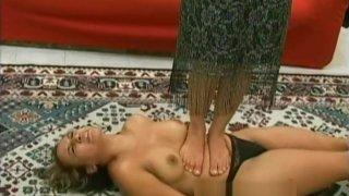 Beautiful feet trampling face image