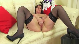English milf Beau puts her sex toy to work image