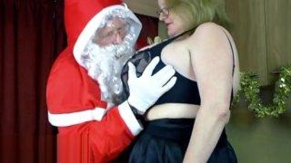 Image: Santa Claus squeezes Sallys big tits