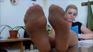 Sexy nylon feet tease in tan pantyhose image