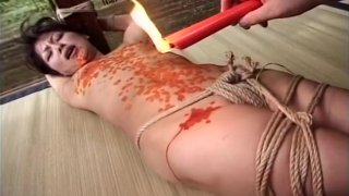 Sexy Japanese girl bounded and covered in_wax image