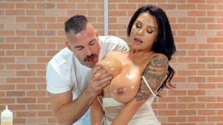 Sheridan Love gets her big natural_tits oiled image
