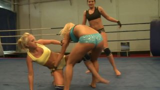 Image: Furious chicks Andy Brown, Carla Cox and Nikky Thorne are fighting in on ring