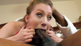 Arietta Adams guzzles the huge black anaconda image