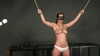 Tied up brunette deep throat and_facial image
