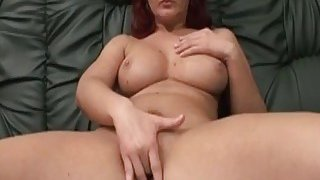 Busty cougar riding amputee schlong on couch image