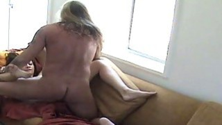 Cheating Brunette Housewife Getting Fucked On The Sofa image