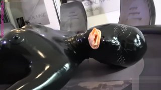 catsuit Mobile video - Girl_in_full_latex_condom_catsuit image