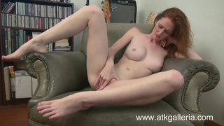 Dee Dee Lynn masturbates comfortably in a chair image
