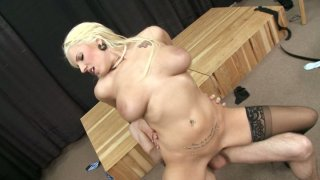 Lylith Lave rides and gets her pussy drilled on the floor image