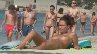 Free barcelona Clips - Busty nude babe spied upon on barcelona beach image