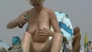 Image: Superb voyeur beach video of a trimmed pussy tanning
