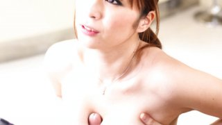 Slutty Hitomi Araki strips out of her maids uniform to clean her bosses clock. image
