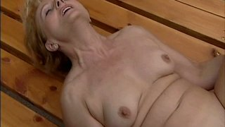 Obese and pale old whore Rita has nothing against being fucked outdoors image