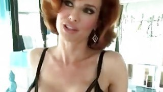 Redhead MILF teases Rocco with her stunning big tits image