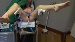 Sensual Doctor Pleasures Female Slave with Gloves, Speculum, and Electro image