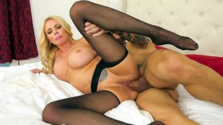 Busty_Briana_Banks_lying_on_her_side_gets_pussy_drilled image