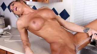 Image: Sexy athletic mom uses the kitchen sink to cum