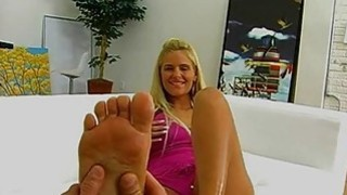 Phoenix Marie gives a footjob image