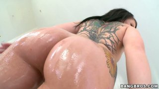 Image: Amazingly curvy brunette Casey Cumz treats her ass with dildo