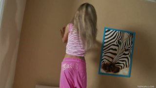 Flexible blonde teen Katie wankers on a bed using her favorite toy image