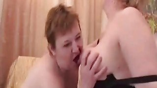 Two lusty mature lesbian sluts please their wet hungry vagina with a sex toy image