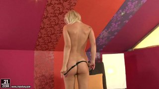European blonde Brigit plays with her pussy and diddles her clit image