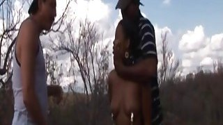 Rough outdoor fucking with an African slut and big cocked studs image