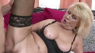 Busty mature riding a cock in black lingerie image