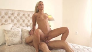 Beautiful blonde Dido Angel gets all dressed up then undresses and takes her man on a fuckfest... image