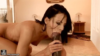 Young curve Liz uses the gigantic black dildo for anal stimulations image