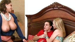 MILF Eva Notty amazing threesome action with young couple image