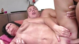 Shaved mature rides a young stud image