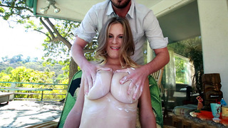 Busty hottie Olivia Blu receiving a nice tit massage image