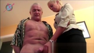 German blonde secreatary makes a rough handjob to her boss to keep her job! image