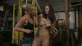 Kathia Nobili ties up bosomy brunette Zyna Babe and spanks her image