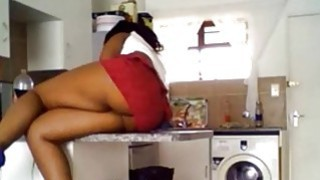 Black girl with juicy ass teasing in kitchen image