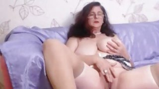 Busty mature with curly hair fingers pussy on webcam image